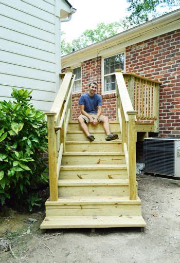 how to build a building how to build a deck it s done railings decking and house