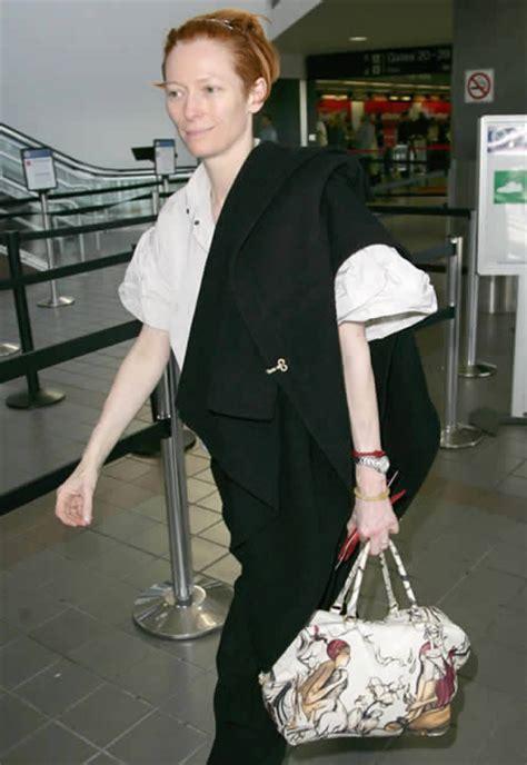 Tilda Swinton And Prada Fairies Handbag with their prada bags purseblog