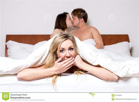 getting wife to swing cheeky young woman in a threesome in bed royalty free