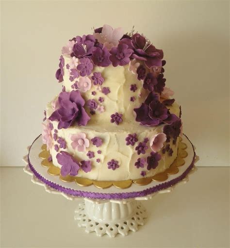 cascading purple flowers birthday cake  tier chocolate cake  whipped ganache filling
