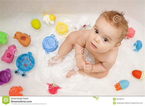 baby in bath tub with toys stock photo image of beautiful