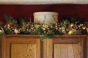 garland for above kitchen cabinets pin by lorie naugle on decor