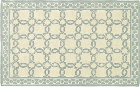 blue and white geometric rug blue rugs promote relaxation in 8 summery interiors