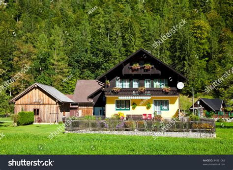 traditional alpine house stock photo image of blooming traditional alpine style house stock photo 84851065