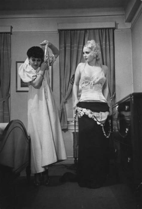 women undressing in bedroom in the 1930s there was a school teaching wives how to