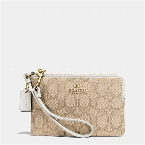 Zip Wristlet coach corner zip wristlet in signature fabric in metallic
