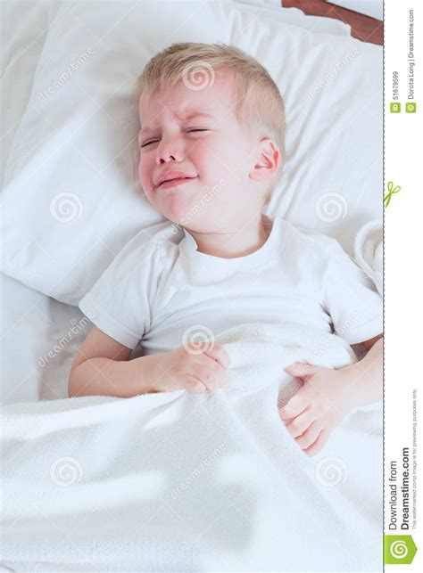 crying in bed sick toddler boy crying in bed
