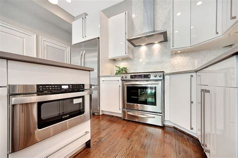 glossy white kitchen cabinets white glossy kitchen cabinets sleek modern who needs ikea yelp