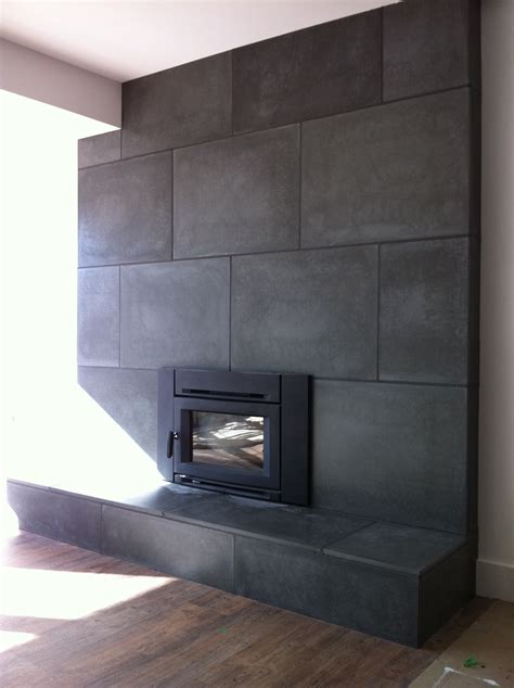 fireplace concrete tiles in basement renovation anthony