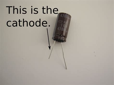 capacitor anode positive or negative make after school kinetic flashlight