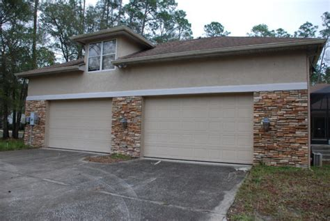 four car garage short sale bank owned pricing saddlewood wesley chapel florida