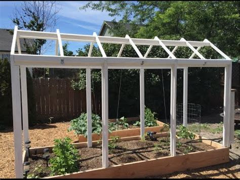 how do i build a greenhouse in my backyard how to build a greenhouse over a raised bed youtube