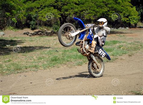 how to wheelie a motocross bike dirt bike wheelie royalty free stock image image 1353896