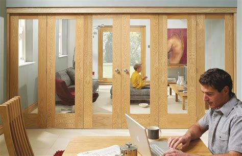 Timber Frame Home Interiors by Internal Folding Sliding Doors Systems Available In Oak
