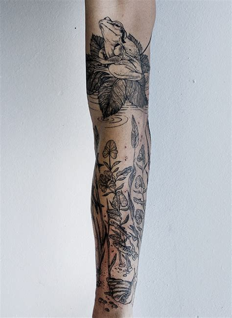 fine lines tattoo line artist creates detailed black ink