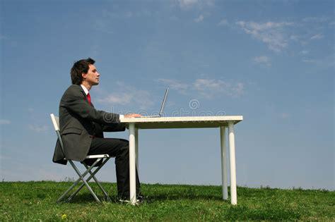 Man Sitting At A Desk Man Sitting At Desk Outdoors Stock Photo Image 2808208
