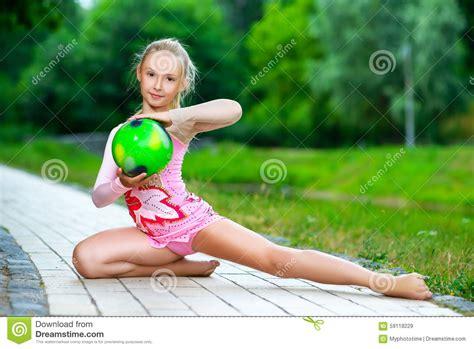 outdoor portrait of young cute little gymnast stock