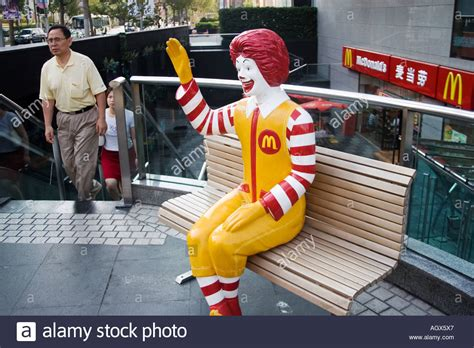 ronald mcdonald bench ronald mcdonald character sits on a bench there are