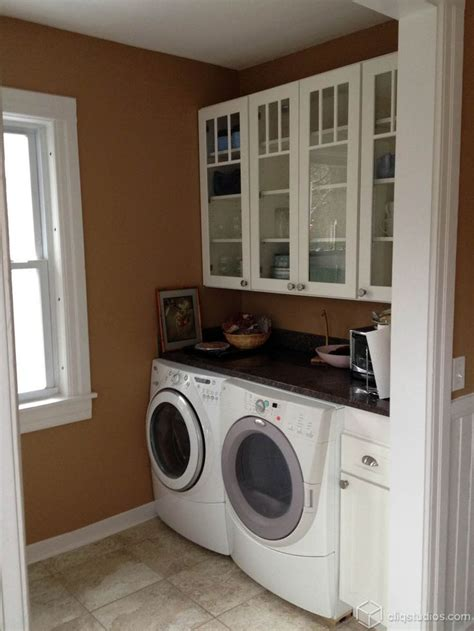 laundry in kitchen ideas 17 best images about laundry room cabinets on pinterest