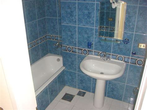 shared shower between two bathrooms chaarani properties chaarani building 2nd floor