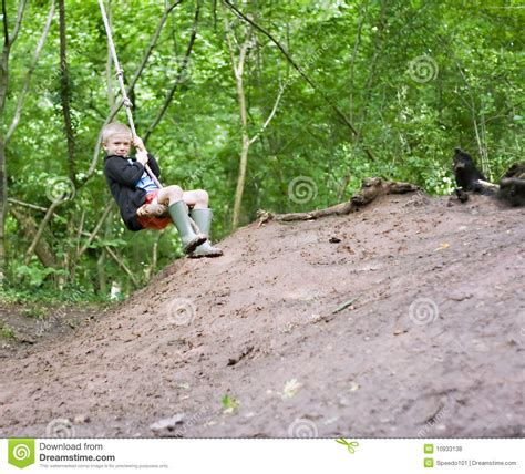 swinging on rope rope swing royalty free stock photos image 10933138