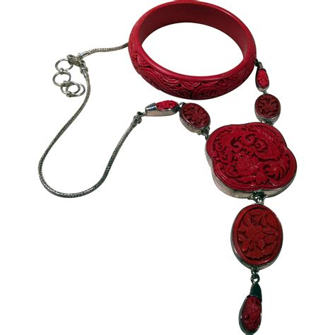 cinnabar silver jewelry set from with an eye on