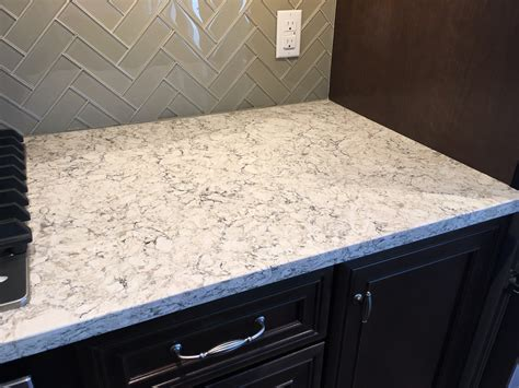 off white cabinetry paired with a glossy neutral tile viatera quartz countertop in aria samantha s kitchens