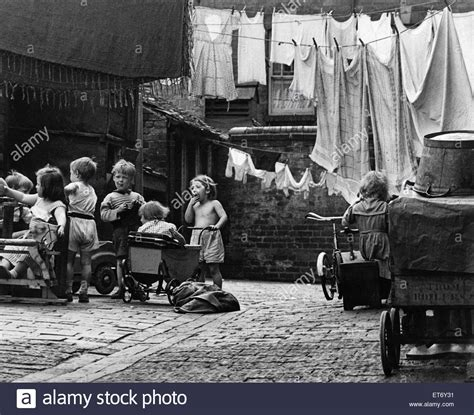 houses to buy in birmingham west midlands slum housing in birmingham west midlands children at play in the stock photo