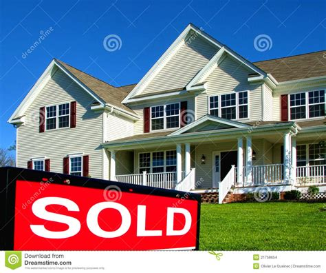 real house real estate realtor sold sign and house for sale stock