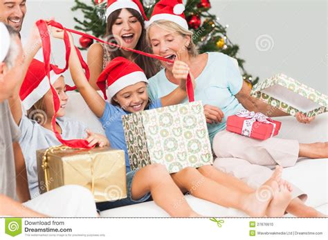 happy family at christmas opening gifts together stock