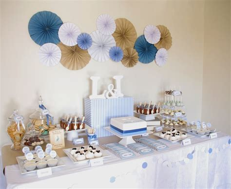 of cake blue brown white christening table