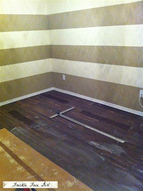 carpenters paper floor faux wood plank floors using brown paper remodelaholic