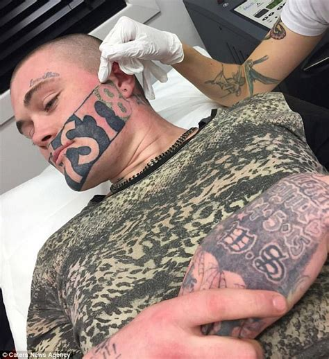 man with devast8 tattooed across his face lands a job as
