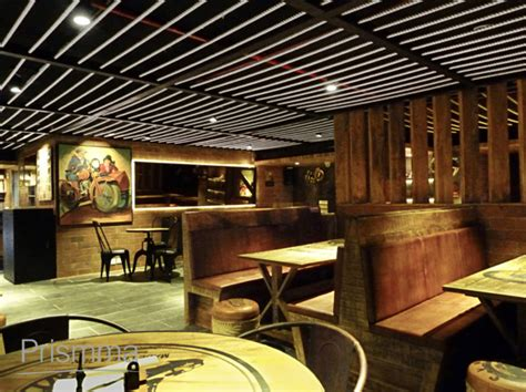 Livingroom Walls kolkata interior designer bikers cafe by icon projects