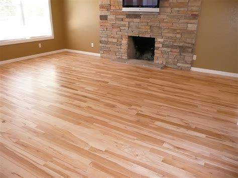 decoration hardwood floor with bright natural wood color floor bricks fireplace in empty room