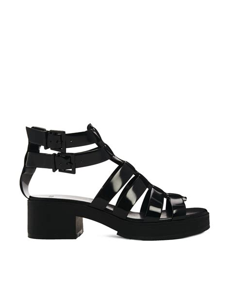 gladiator jelly sandals asos flower pot gladiator jelly sandals in black lyst