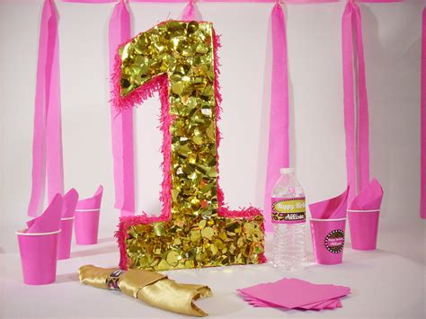 1st birthday party centerpiece in pink and gold princess