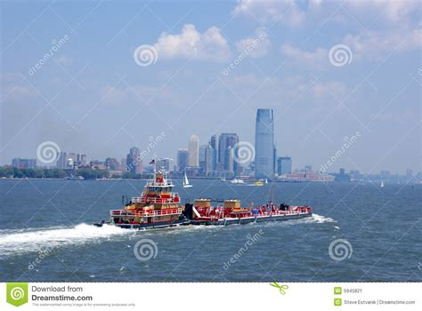 u boat new york harbor tugboat pushing barge in new york harbor stock image