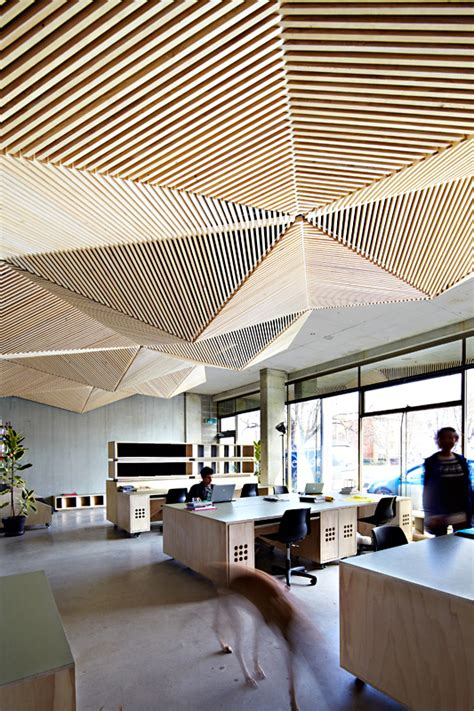 cool ceilings assemble studio s amazing wooden and geometric office