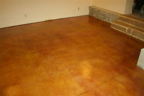 acid stained cement floor in a basement for the home
