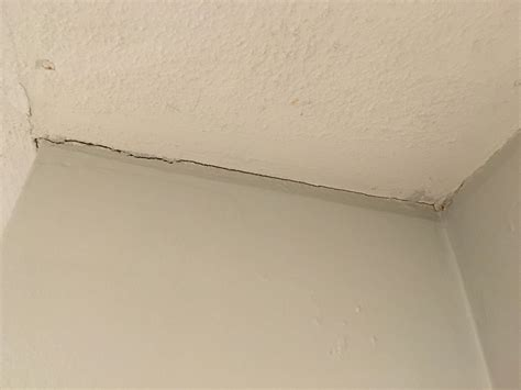 Filling Cracks Between Wall And Ceiling by Drywall Bought A 20 Year House Last And It