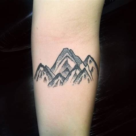 mountain tattoo on the forearm by craigy lee