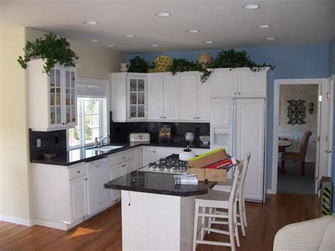 kitchen colors with white cabinets white kitchen cabinets green granite countertops enlarge