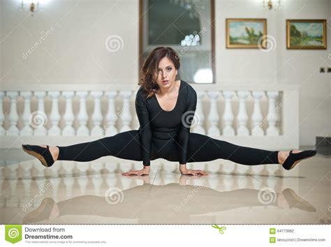 dancer with short hair graceful ballerina doing the splits on the marble floor