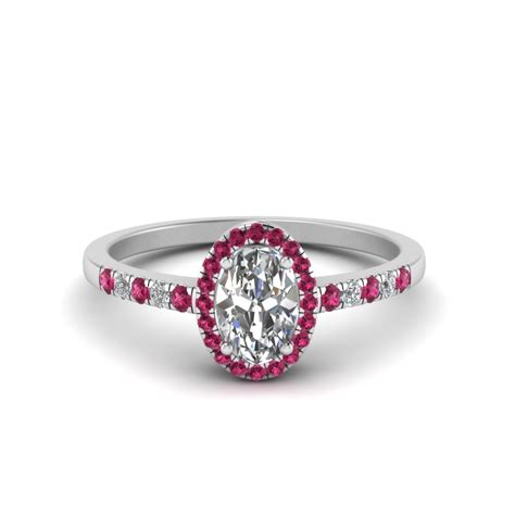 oval halo delicate engagement ring with pink