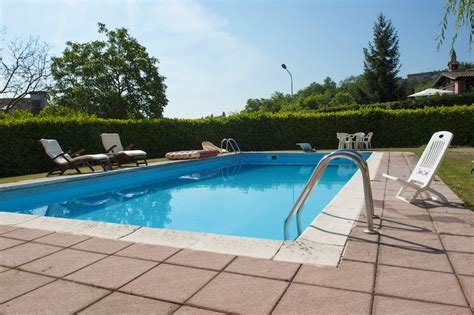 backyard swimming pools cost how much money does it cost to build a backyard swimming