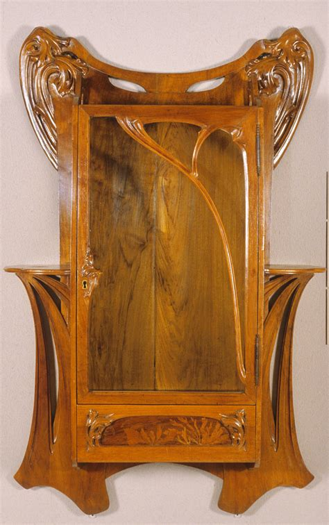 art nouveau couch wall cabinet by attributed to louis majorelle