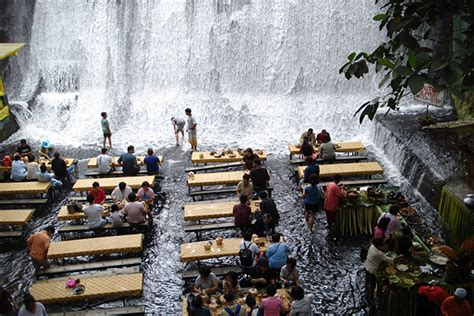 villa escudero waterfalls restaurant water runs over your feet as you dine at the amazing villa