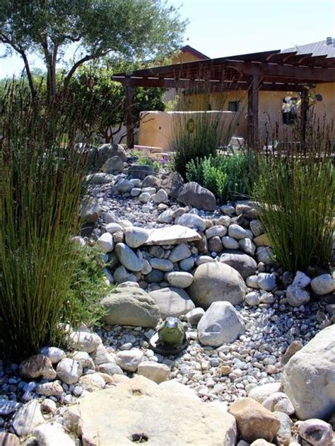 rock garden south using pebbles and rocks you can create a river bed