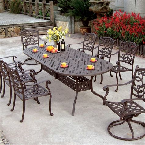 cast aluminum patio table and chairs mahogany dining room table and 8 chairs six 360 degree